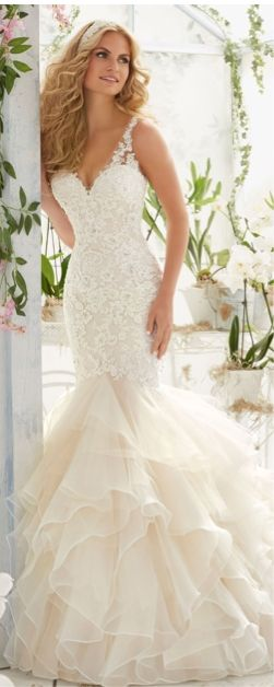 Fit-and-flare designer wedding dress by Mori Lee.