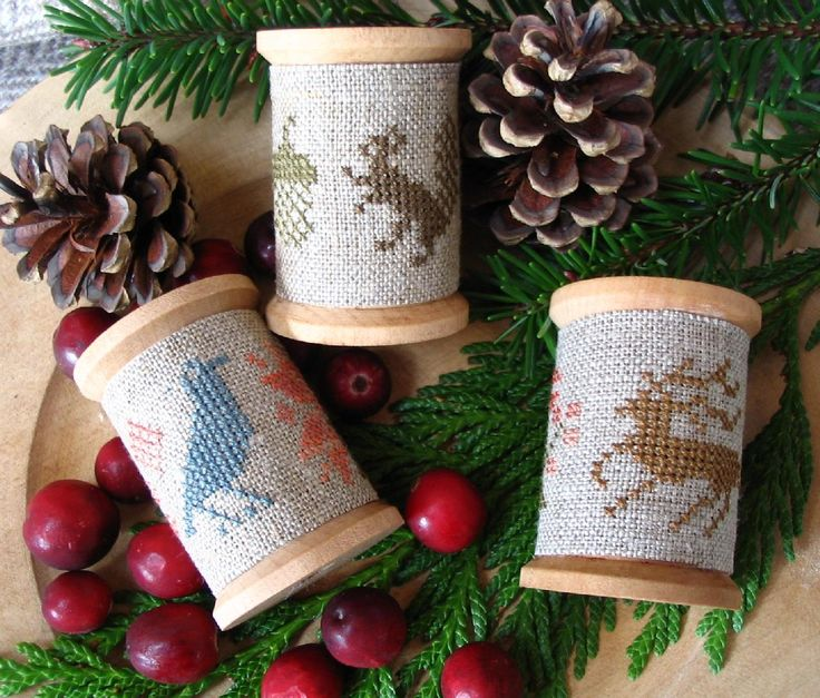 These Counted Cross Stitch wooden spool ornaments would be quick and easy to do…