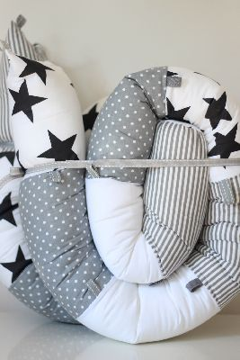 Snake-snail pillow - black & white:- Beautiful soft cushion with countless uses: to strengthen the shoulder belt , roll and as a development soft toy & more.  Can also be used as a bumper for baby bed.  When the baby grows and moves into toddler's bed, he can have his favorite snake to protect him from the side of the wall  Price: $69