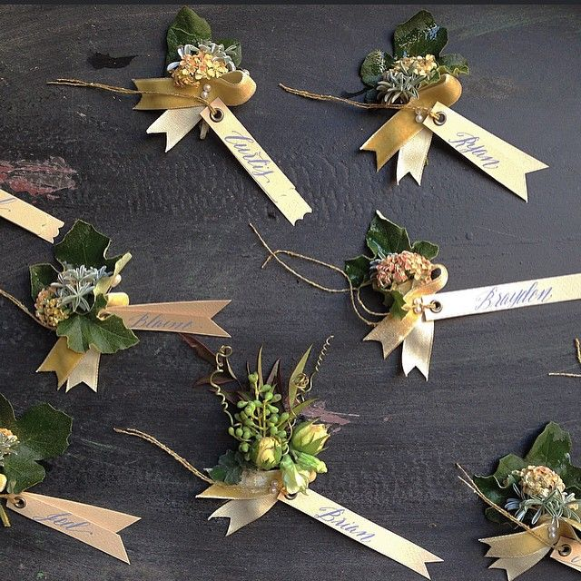 "These are our ""lapel awards"" - tiny boutonnières that were inspired by horse show ribbons.... Tags by @bbpaperandink  #loloandbrian @lauriearons #iphonephoto"