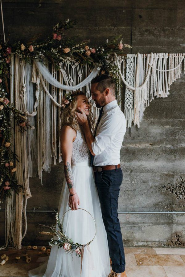 Add some bohemian flair to your wedding ceremony with a floral adorned macrame backdrop   photo by Jessica Heron, wedding design by SueBlue Events, floral design by Tribes N Pines, rentals by Vintage Meets Modern and SueBlue Event Rentals, backdrop by Work/Shop PDX