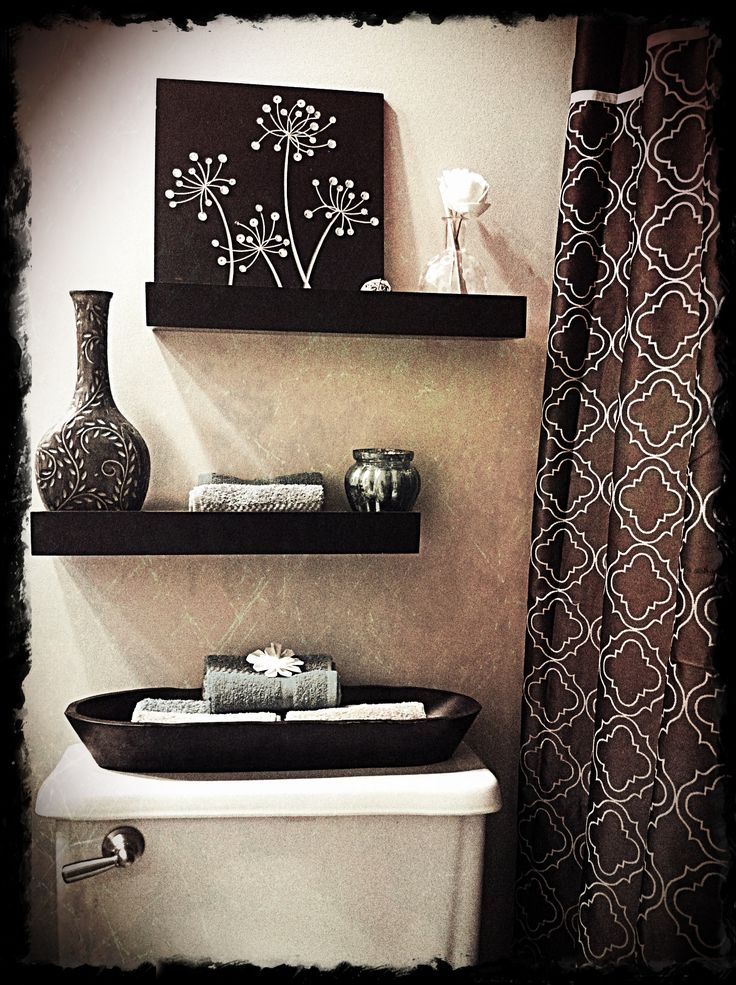 shelves make better use of a small space and something to go right above the toilet bowl will also make less white walls.