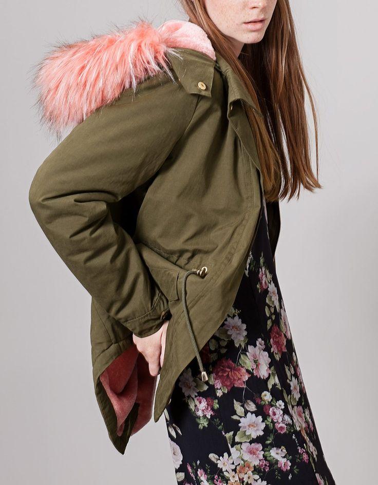 Khaki parka with pink faux fur hood