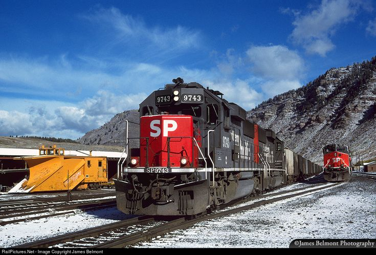 A pair of SP GP60s lead the Malta Turn out of Minturn Yard with 25 cars on Sept. 27, 1996. Russell snowplow X-67, built for the Rio Grande in Jan. 1950, awaits an opportunity to clear the yard of heavy winter snow.