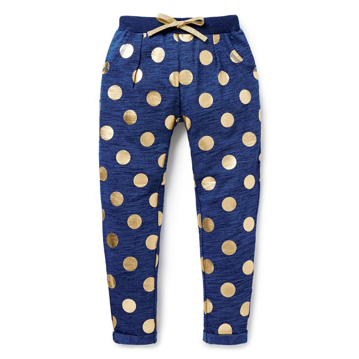 100% Cotton slub. Full length trackie pant features all-over gold foil spot. Relaxed fitting silhouette with elasticated waistband and gold drawcord. Available in Dark Indigo.