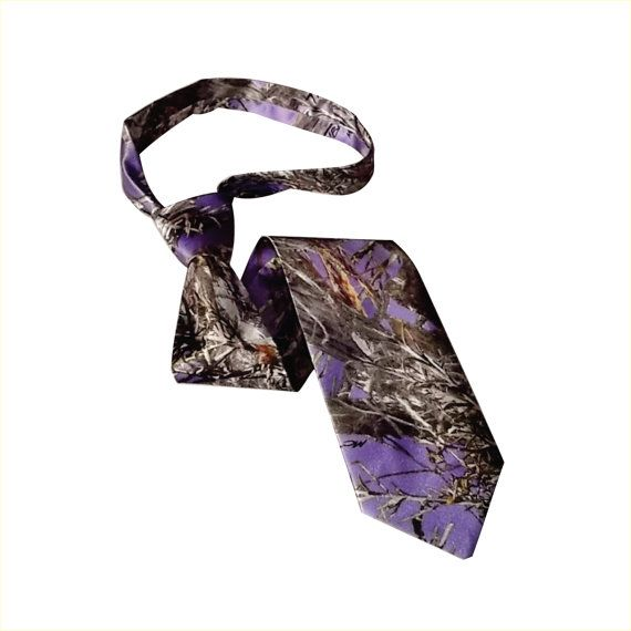 This camo necktie is made with True Timber purple satin fabric that will not conceal you. It is shiny and the colors vibrant on this 100%
