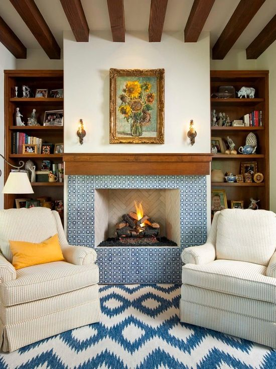 Classically Spanish Hearth and fireplace mantel with gorgeous blue tile.