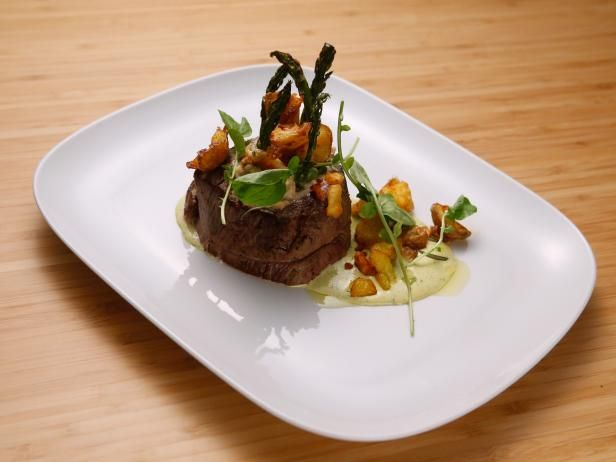 Get Oscar-Stuffed Beef Tenderloin with Rosemary Potatoes and Bearnaise Recipe from Food Network