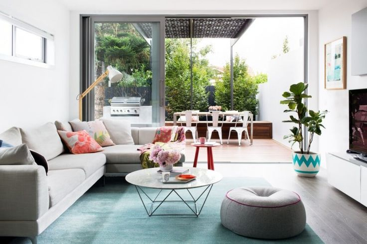 Drool-worthy living room featuring soft blue rug, geometric and marble coffee table, large grey sofa and gorgeous cushions. It's a corner of stylist Aimee Tarulli's home, see more on the blog now...