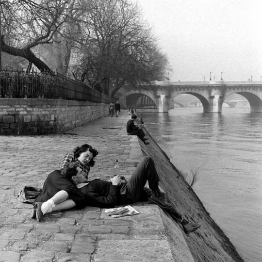 A couple relaxing on the banks of the Seine River in Paris, France - during the spring of 1949. (Nat Farbman—The LIFE Picture Collection/Getty Images) #Paris #France #TBT