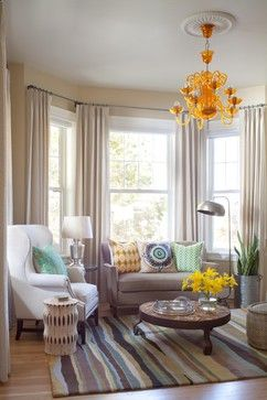 I like the way the seating integrates the bay into the main seating area. Too often it's blocked off by furniture or is an underused nook with plants or a single chair. The colours are wonderful too as well as the eclectic combination of styles. I doubt I'd ever choose a tangerine chandelier but it works in this space. (Lo-Hi Residence)