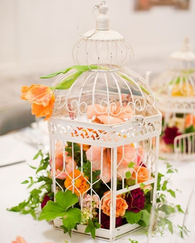 birdcage centerpiece with florals #diy | 20 DIY Wedding Centerpieces via Brit + Co.