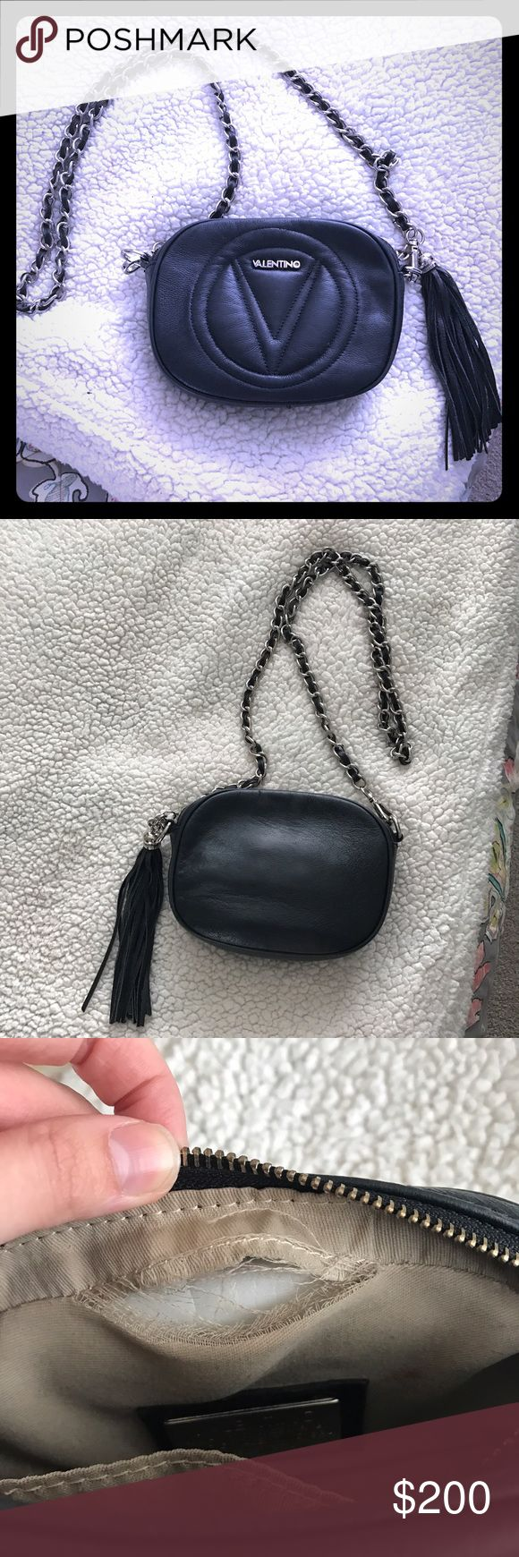Black Valentino Crossbody Black leather Valentino by Mario Valentino Crossbody, torn on inside but otherwise excellent condition! No trades! Mario Valentino Bags Crossbody Bags