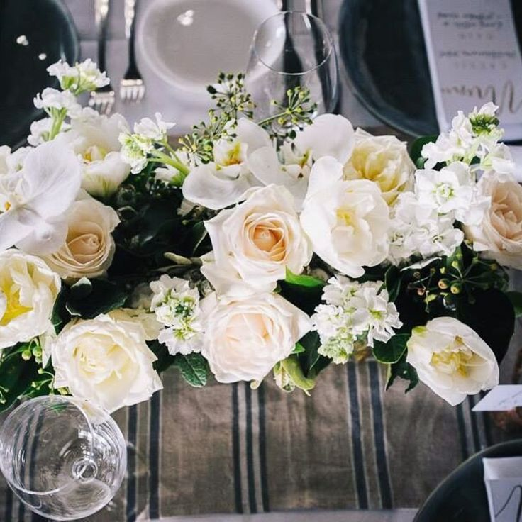 Elegant white roses for one of our wedding reception dinners