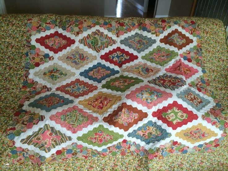 Hand pieced, machine quilted, Moda fabric Charisma. This was made with a jelly roll and a layer cake.