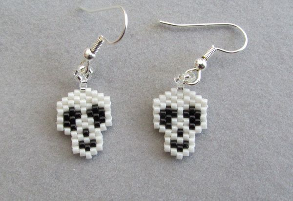 Tiny Skull Earrings in delica seed beads for Halloween by DsBeadedCrochetedEtc on Etsy https://www.etsy.com/listing/159239094/tiny-skull-earrings-in-delica-seed-beads