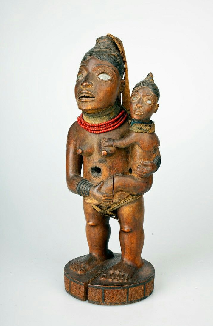 Standing Female with Child (Wife of Mabyaala?) (Nkisi) l Kongo peoples, Vili group, Loango coast, Cabinda, Angola l 19th century, inventoried 1885 l Wood, beads, glass, fiber, copper, resin, pigment l  H. 151⁄4 in. (38.5 cm), W. 53⁄4 in. (14.6 cm), D. 51⁄2 in. (14 cm) l Collection Nationaal Museum van Wereldculturen, Netherlands.