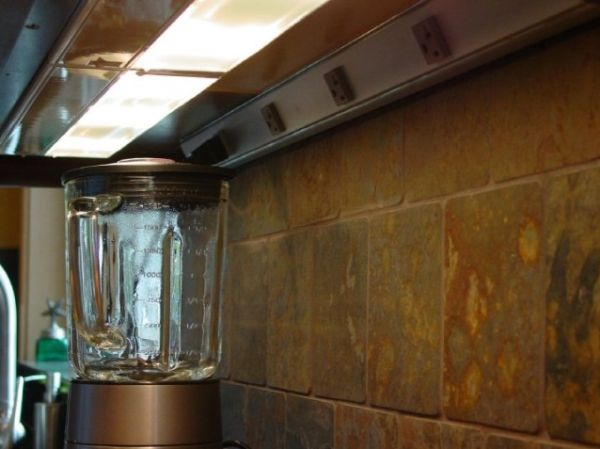 the convenience of strip outlets added at the back of the cabinet. task lighting, undercabinet lighting, lighting placement, kitchen lighting