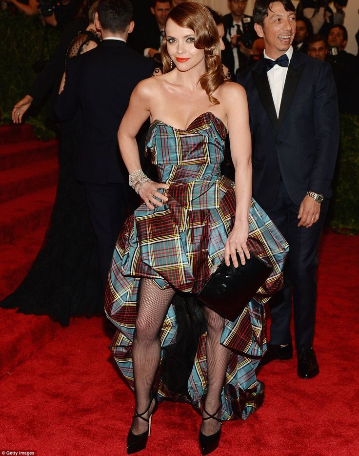 That's the spirit: In her tartan dress, fishnet tights and platform shoes, Christina Ricci nailed the theme @ 2013 met gala