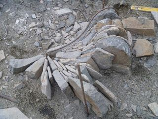 This dry stone 'fire-circle', built by Callum Gray, was inspired in part by the one in Dan Snow's book 'In the Company of St...