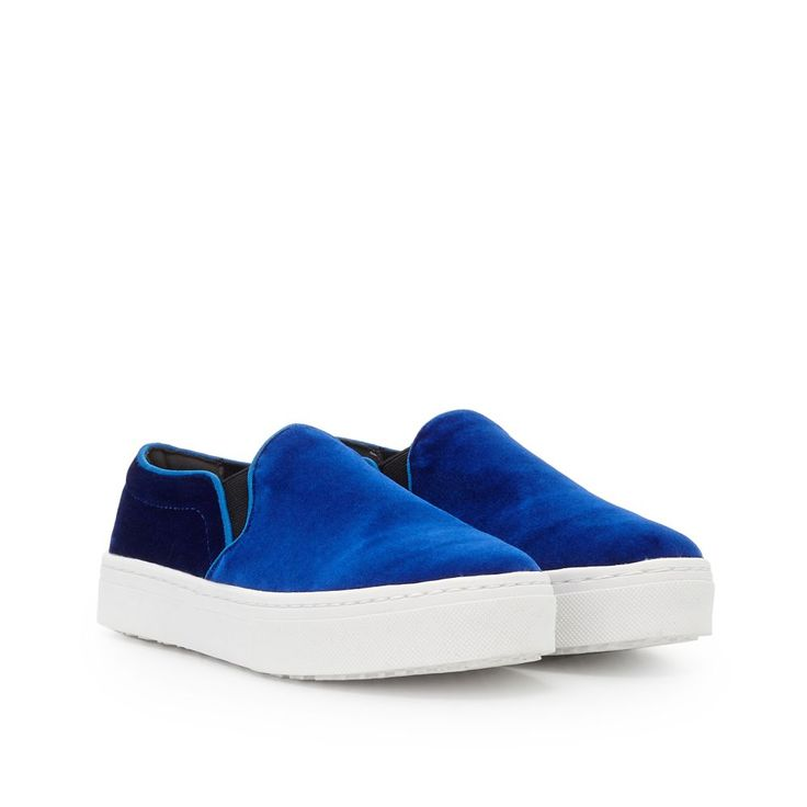 Our Lacey velvet slip-on sneaker combines the seasons hottest footwear trends, velvet and sneakers. Designed in royal blue, black, and burgundy velvet and set atop a white sole, this pair is perfect for work and weekends alike. Style them with skinny black jeans and a silk bomber jacket for the ultimate in downtown coolLacey Velvet slip on sneakerSpecial Details: Rich Velvet Fabric Detailing  Closure: Elastic Slip OnToe: Rounded Toe Material: VelvetInsole: Synthetic