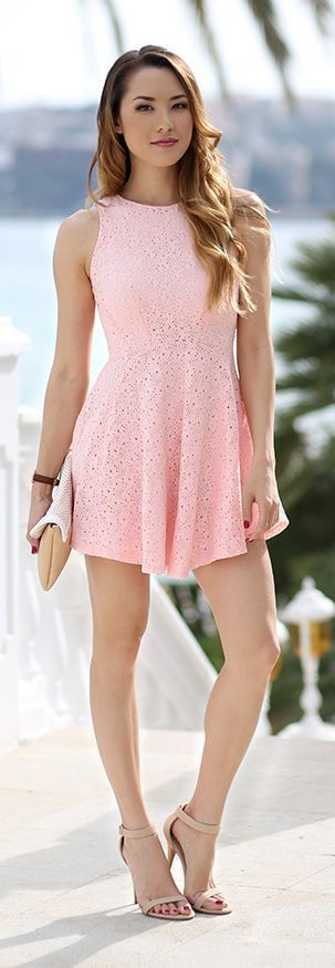 Pair a pink eyelet dress with strappy heels for a cute summer look.