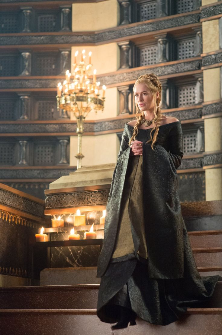 Cersei in a blue / black dress - these more humble yet graceful colours represent more peace on Cersei than the red colours. Whatever she wears, she'll still remain a woman of strength.