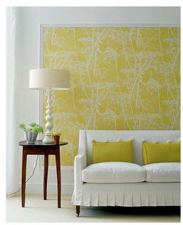 If you have a large blank wall that you don't know what to do with, consider framing up some wallpaper! forget buying an expensive frame. Get some trim moulding cut to the proper size at Home Depot and paint it white. This makes for a dramatic (but inexpensive) piece of wall art. Cool, huh?