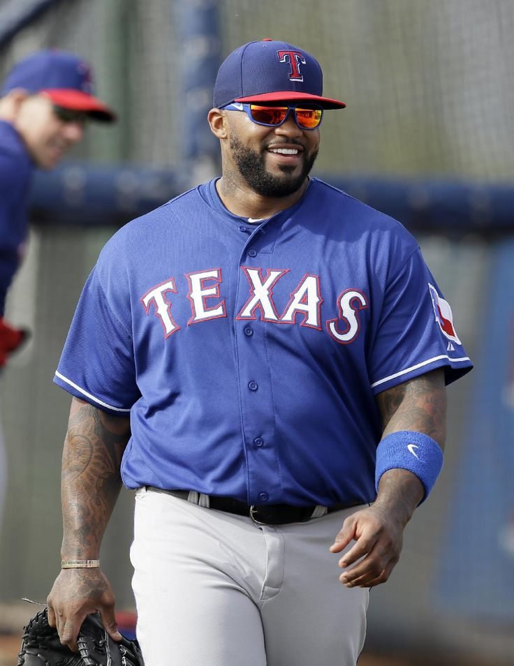Texas Rangers' Prince Fielder prepares to take batting practice as he works out with his new team for the first time during spring training baseball practice, Wednesday, Feb. 19, 2014, in Surprise, Ariz. (AP Photo/Tony Gutierrez)