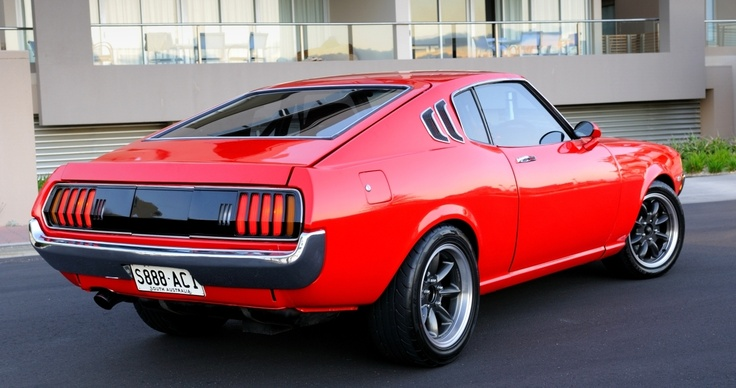 1970's Toyota Celica perfectly done. Simple red body drop and nice wheels.
