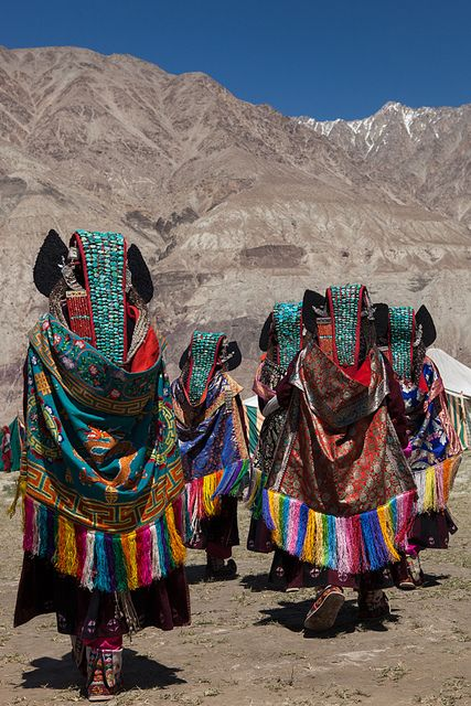 *Ladakhi women wearing ethnic traditional clothing and Perak (turquoise encrusted hats) at a local fair in Sumur village.  Silk route festival, Sumur, Ladakh, Jammu and Kashmir, India.*