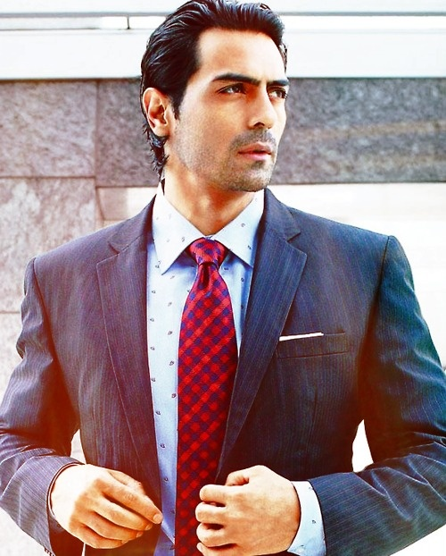 Model + actor Arjun Rampal. A good suit, polka dot shirt and plaid tie make the man. #Bollywood #fashion