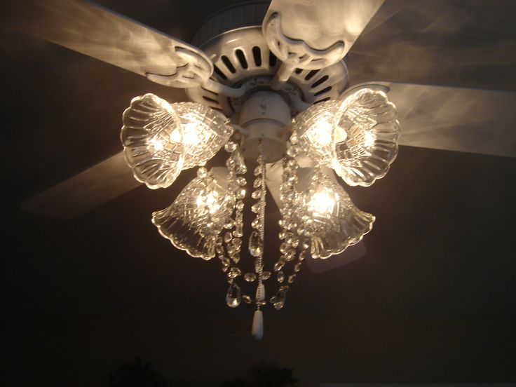 Ceiling fan (after picture) painted white and made into a fan chandelier. Added crystals with chandelier magnets from Hobby Lobby