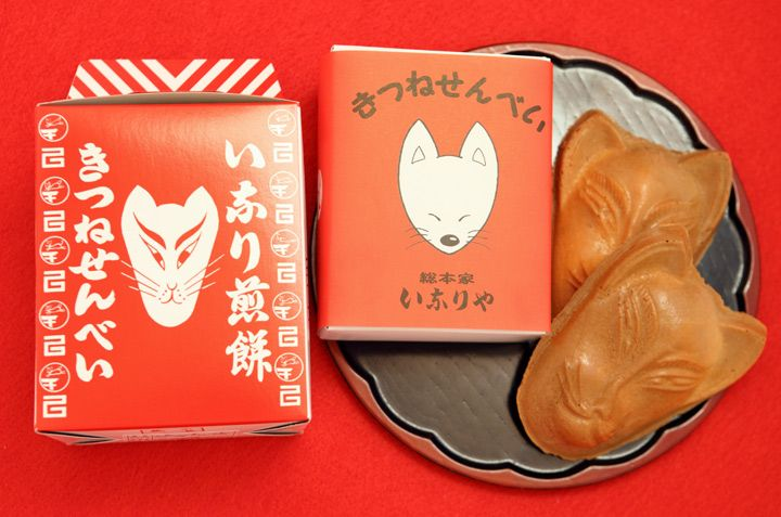 Kitsune Senbei A unique senbei in the shape of a kitsune, or fox, mask, sold at Fushimi Inari Shrine. Foxes are well loved at the Fushimi Inari Shrine as the servants of the gods. The senbei batter is mixed with white miso which when baked, gives it its orange color.