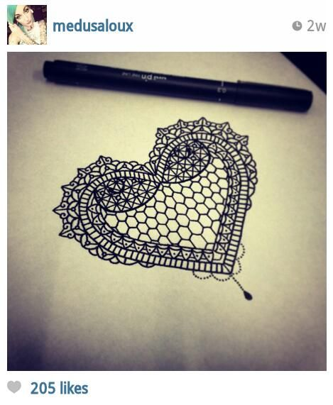Intricate lace heart tattoo design