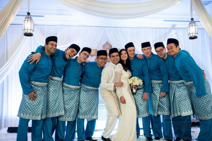 Handsome groomsmen in matching traditional Malay outfits!