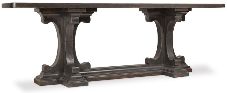 Alluring accents offered in the Auberose Collection include the dramatic hall console and carved landscape mirror.