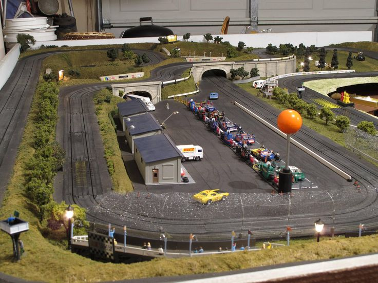 My dad has been working on this slot car track for the past 15 years. It's finally finished. - Imgur