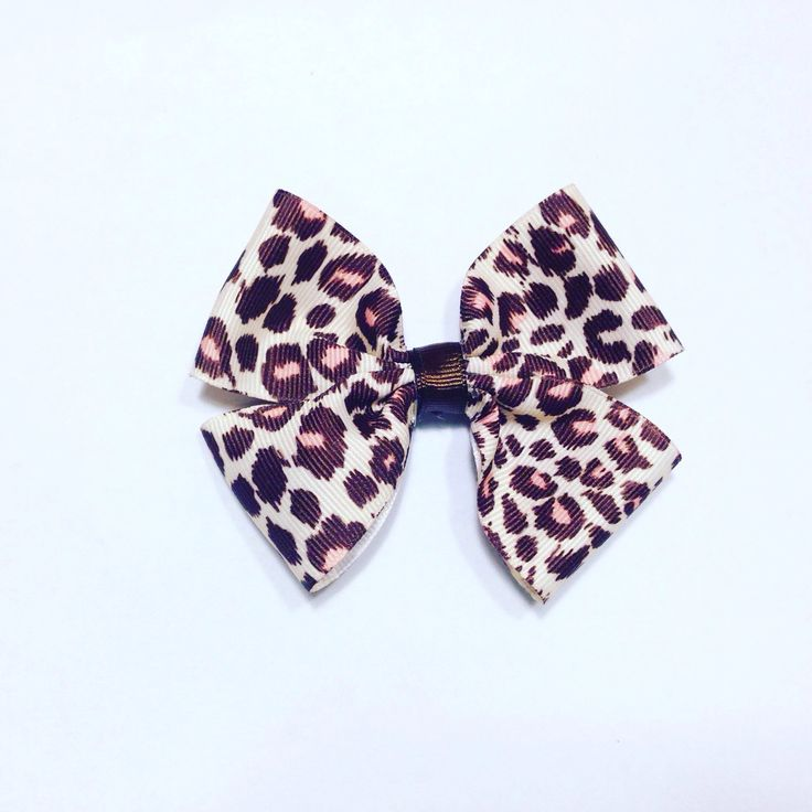 Cheetah print hair bow-Hair accessories-Hair Clips-Animal print hair bow-Ribbon Hair Bow by ShopNicoleRay on Etsy https://www.etsy.com/listing/289418935/cheetah-print-hair-bow-hair-accessories