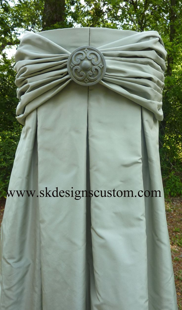 """Great treatment for narrow spaces between windows - this is about 9"""" wide. Inverted pleat silk panel with rouched and gathered overlay with center medallion accent by www.skdesignscustom.com"""