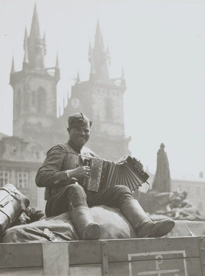 RUSSIAN SOLDIER WITH ACCORDION, MAY 9TH 1945.