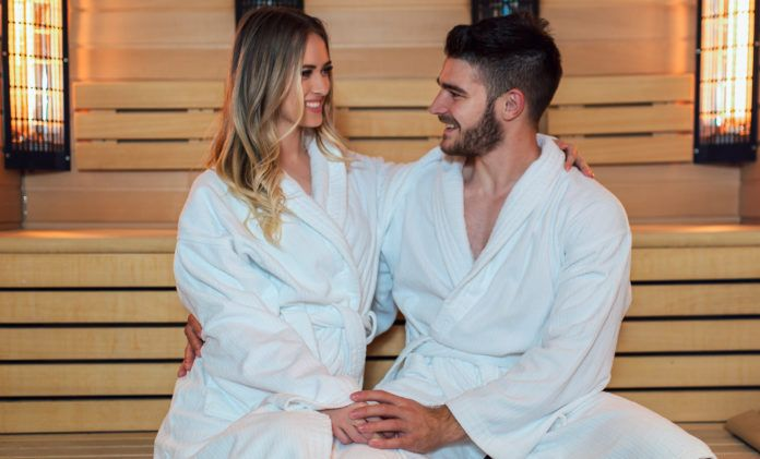 Young couple relaxing in the sauna - Thai Massage and Day Spa