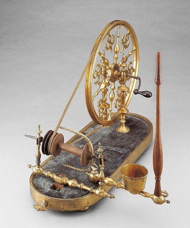 A SALON SPINNING WHEEL, France, circa 1800. Gilt - by Koller Auctions
