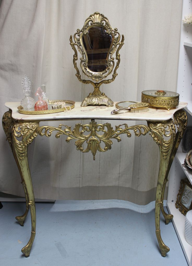 Southern Charm would love to custom style a dressing vanity to create a gorgeous one-of-a-kind backdrop for you day of wedding photos and bridal portraits.  This elegant table is perfect for a vintage vanity, cake table, welcome table or beverage station.  Don't worry!  We'll help pull the look together from our elaborate prop rental collection.