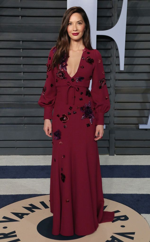 Olivia Munn from 2018 Vanity Fair Oscars After-Party  The actress posed confidently in a crimson gown adorned with floral appliqués.