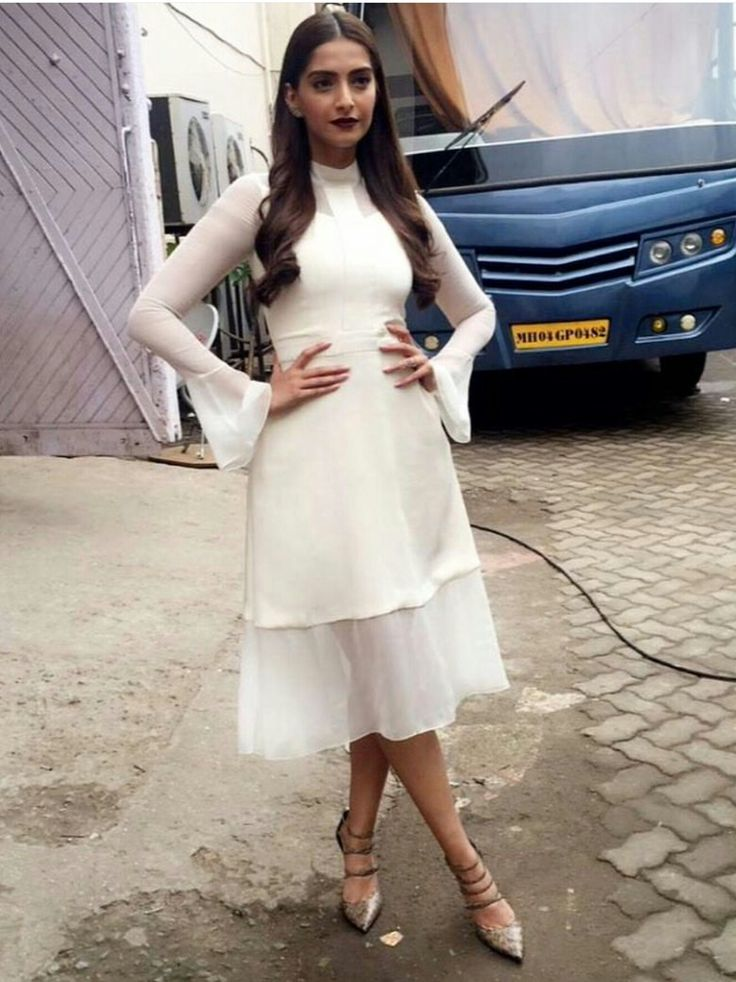 Sonam Kapoor in a off white bell sleeve dress
