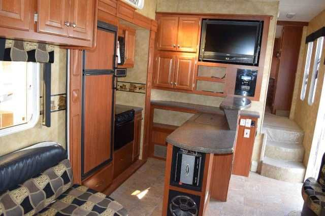 2009 Used Heartland CYCLONE 3950 Toy Hauler in California CA.Recreational Vehicle, rv, 2009 Heartland Cyclone 3950! Luxury fifth wheel toy hauler at an affordable price. Take all the amenities of home on the road with you in this trailer. Triple slide, Onan 5500 generator, Fuel station, 12 ft. garage, power awning, huge pass through storage, large kitchen with solid surface countertops, flat screen TV, U-shaped dinette, large double loft with 2 beds, upgraded stereo with subwoofer and amp…