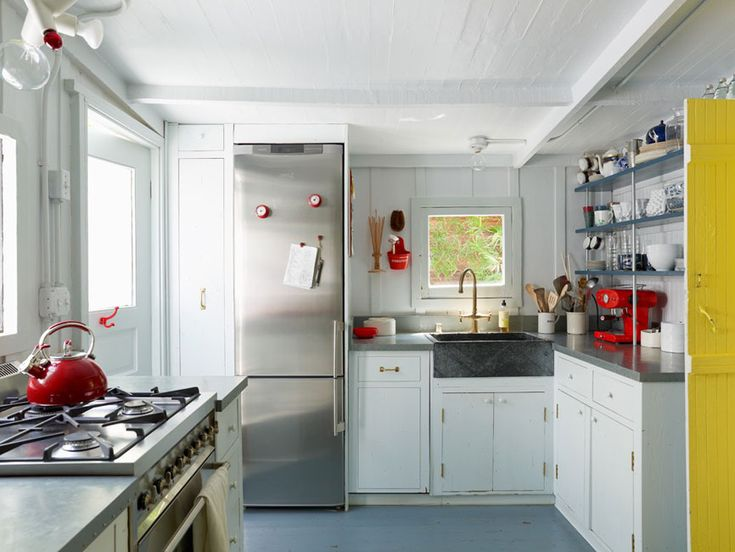 I want that fridge if I ever have a cabin.  Plus the farm house sink and those shelves!