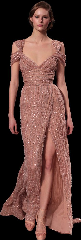 What gorgeous beaded fabric--so in tune with the trend for heavy embellishments.  Elie Saab