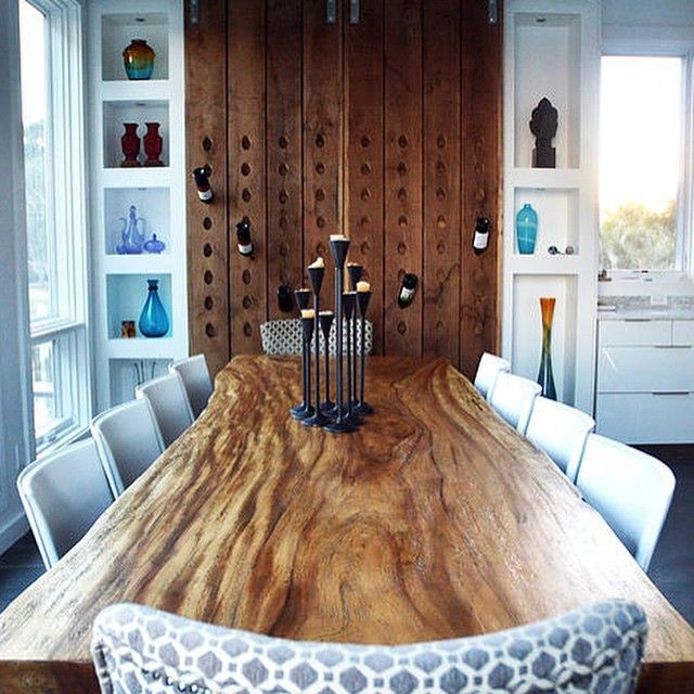 Live edge dining table + unique wine wall by Holz Design Group.